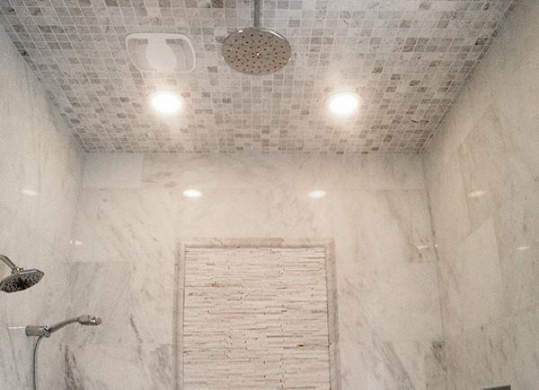 white-carrera-marble-shower
