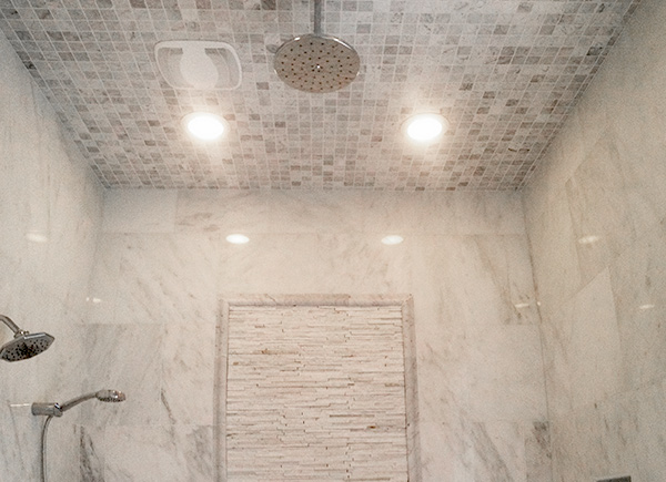 white-carrera-marble-shower